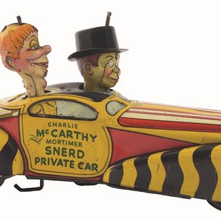 Depicts Charlie McCarthy riding in sun-top car with his pal