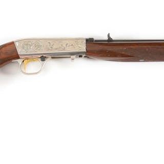 This engraved Belgium Browning features squirrels on...