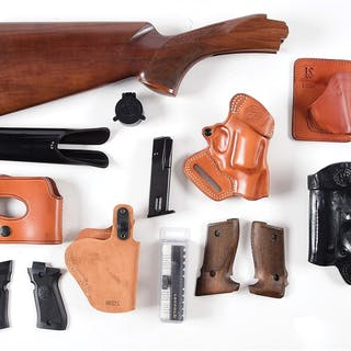 Large collection of gun accessories with some holsters