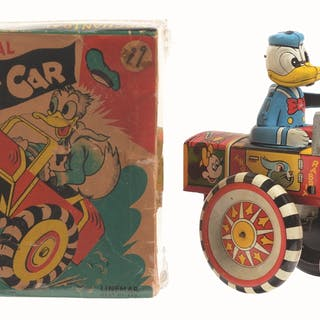 Comes with colorful original box showing Donald driving car on front