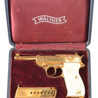 This fabulous pistol is complete gold plated
