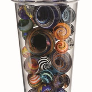Includes a number of vortex marbles and marbles made by...