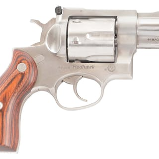 Stainless steel Ruger Redhawk double action revolver with factory case