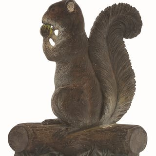 Profile view of sitting up squirrel