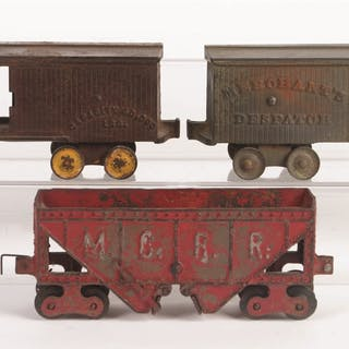 Set consists of three freight cars: first is a Dent...