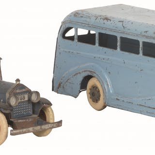 """First is a 1920s 16"""" long wind-up with one replaced tire"""
