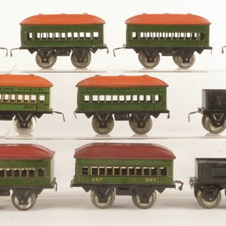 Lot consists of: a red wind-up Joy Line Steam Locomotive