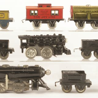 Lot consists of: a red-painted wind-up Joy Line Locomotive