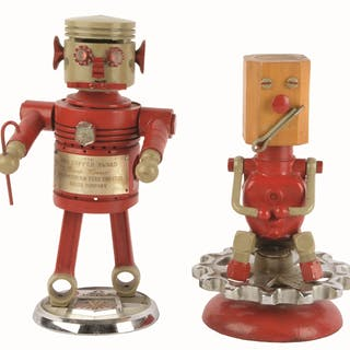 This is a great lot of two robot advertising figure awards