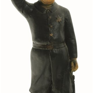 "Circa 1920s chalkware policeman is 19"" tall and depicted with a raised hand"