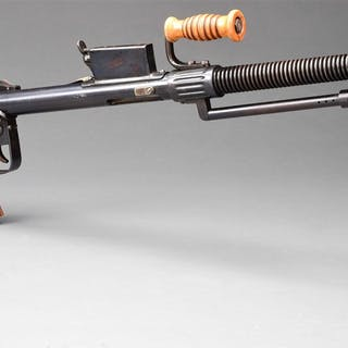 Rather rare Japanese training machine gun which bears a...