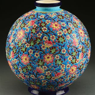 A large spherical vase with all over floral design in colors of yellow