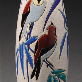 Catteau vase is decorated on the front with two birds...