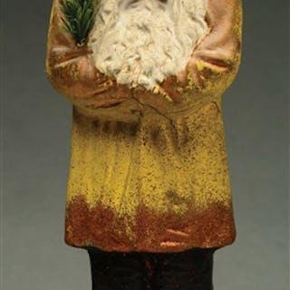 Antique Santa Belsnickle depicted holding fir tree