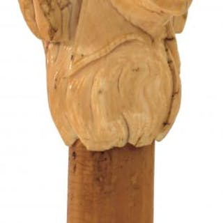 A 19TH CENTURY WALKING CANE, the early ivory handle carved as the