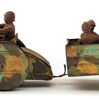 A CLOCKWORK TINPLATE TROOP TRANSPORTER AND TRAILER, c.1937, by an