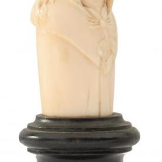 A 19TH CENTURY IVORY WALKING CANE HANDLE, carved as the bust of the