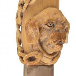 A 19TH CENTURY WALKING CANE, the ivory pistol grip handle carved in