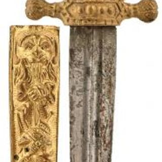 A CONTINENTAL ROMANTIC DAGGER, 11.5cm double fullered blade, cast