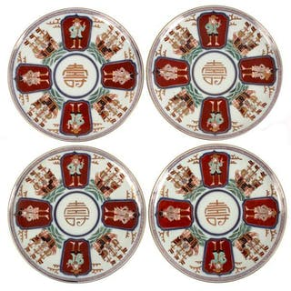 A set of twelve Japanese Imari plates, painted with Dutch sailors