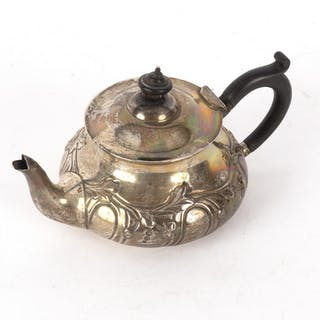 A silver teapot, E&D, London 1905, of circular form embossed foliage
