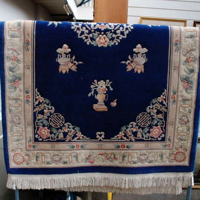A large blue ground modern chines woollen rug