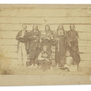 (AMERICAN INDIANS--PHOTOGRAPHS.) Photograph of a white man and 6 Indians