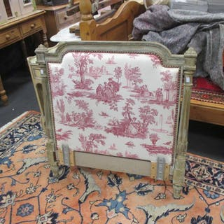 An upholstered French single bed headboard