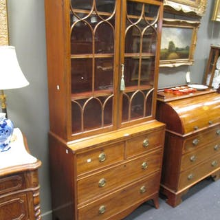 A George III mahogany glazed bookcase on chest of drawers base, 199cm