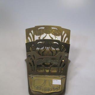 A set of Edwardian postal scales and a brass Art Nouveau letter rack