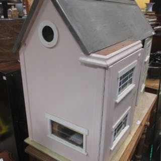 A late 20th Century doll's house, the front as three doors, with some