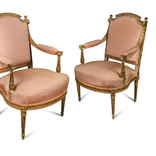 A pair of Louis XVI style carved gilt wood armchairs, upholstered