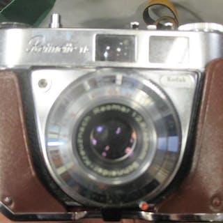 Three sets of binoculars and three cameras (6)