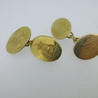 A pair of 18ct gold double ended cufflinks, each with oval flat plaques