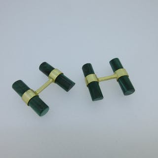 A pair of malachite baton double-ended cufflinks, each end with a