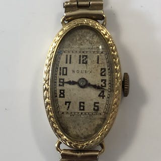 Rolex - A lady's 18ct gold wristwatch, circa 1924, the signed square