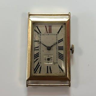 An Art Deco 18ct gold gentleman's wristwatch head, circa 1923, the
