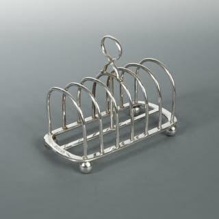 An Edward VII silver toast rack, by the Goldsmiths' and Silversmiths'