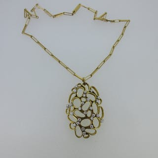 Susan Wright - a diamond pendant and chain, the pendant of oval outline