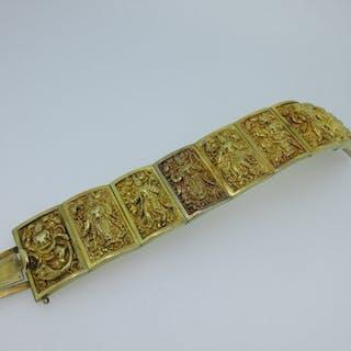 A panel bracelet depicting a Hindu goddess, the nine slightly convex