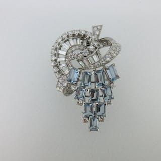A mid 20th century diamond and aquamarine clip brooch, designed as