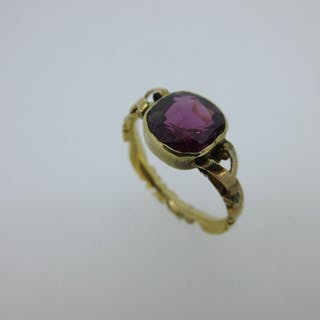 A Georgian single stone garnet ring, the mixed cushion cut purplish