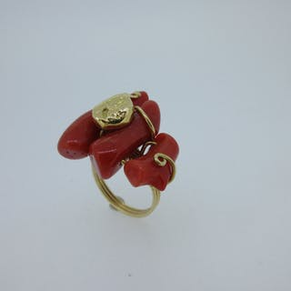 A modern Italian red coral ring stamped '750', the asymmetric design