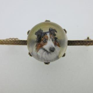 An Essex crystal bar brooch depicting the head of a dog, the circular