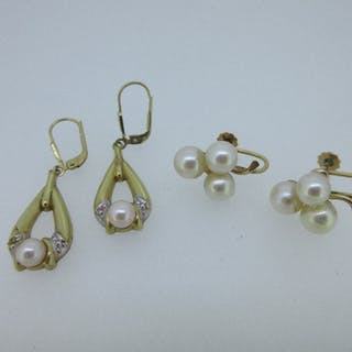 Two pairs of cultured pearl earrings both stamped for 14ct gold, the