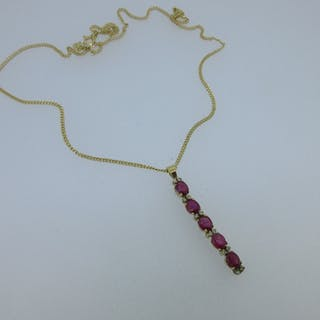 A ruby and diamond pendant with an 18ct gold chain, the pendant designed