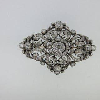 An imposing Victorian diamond brooch, of open form, horizontal diaper