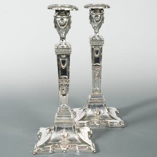 A pair of silver plated column candlesticks, in the neo classical