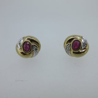 A pair of gold, ruby and diamond earstuds