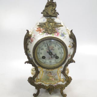 A 19th century gilt mounted French porcelain mantel clock